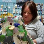 Cindy wire wrapping a sea glass lamp