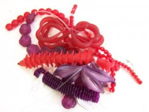 Purple and red beads to make jewelry